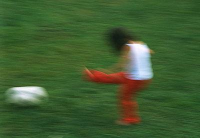 Girl playing football - p567m720792 by Joachim Grusell