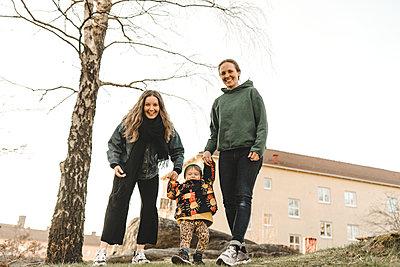 Women with daughter having walk - p312m2207674 by Stina Gränfors