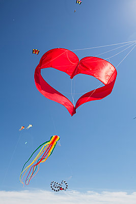 Heart-shaped and other kites in the sky - p300m1549445 by Jan Tepass