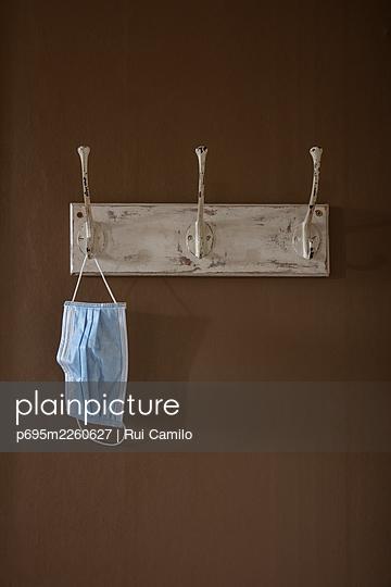 Masks on a coat hanger - p695m2260627 by Rui Camilo