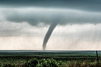 Scenic tornado approaching the town of McLean, Texas, USA - p429m1494497 by Jessica Moore