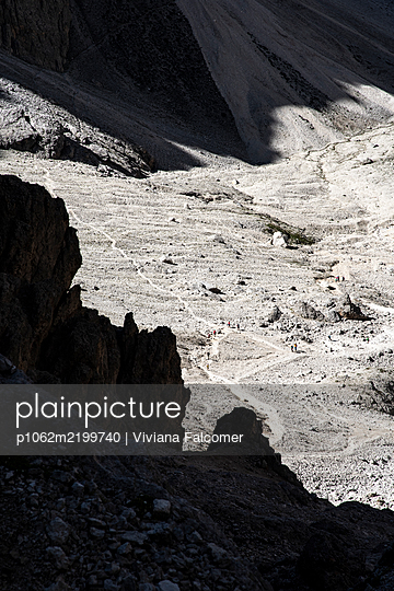 Hiking through a lunar landscape, Dolomities, South Tyrol, Italy, Europe - p1062m2199740 by Viviana Falcomer