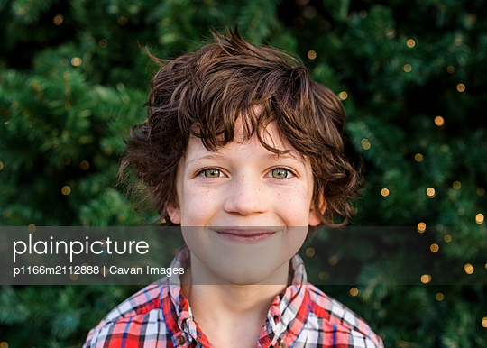portrait of a small happy child gazing directly at camera - p1166m2112888 by Cavan Images
