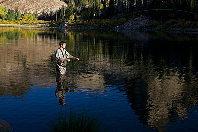 A man fly fishing in a lake - p3018685f by Edward McCulloch
