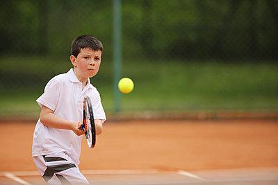 Caucasian Boy Playing Tennis - p3071256f by Koji Aoki