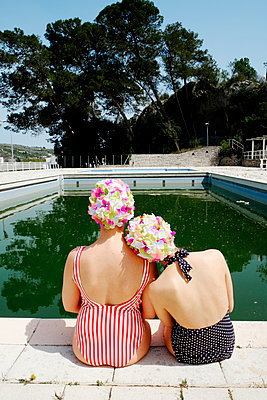 Two young women by the pool - p1521m2081631 by Charlotte Zobel