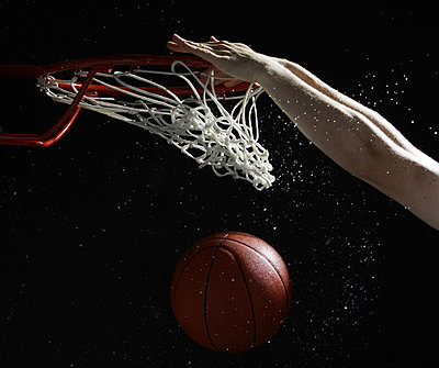 Hands of player slam dunking basketball into hoop - p3071232f by Yosuke Tanaka