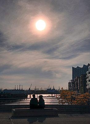 Evening at the port of Hamburg - p382m2184629 by Anna Matzen