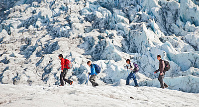 Family walking on glacier - p429m726999f by Henn Photography