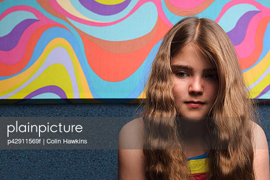 Young girl with abstract painting