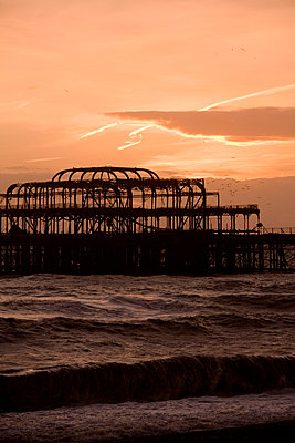 Brighton with burnt down jetty at sunset - p2686365 by James Wadey