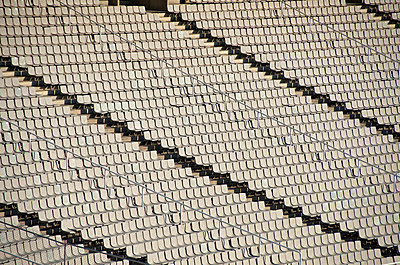 Rows of empty seats in sport stadium - p301m714607f by Etienne Girardet
