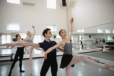 Male and female ballet dancers practicing in dance studio - p1192m1403474 by Hero Images