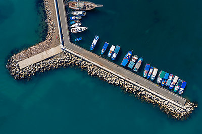 Aerial view to a boats in the port - p1596m2204673 by Nikola Spasov