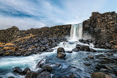 Waterfall on rocks, Pingvellir, Southern Iceland, Iceland - p555m1491157 by Patrick Lienin