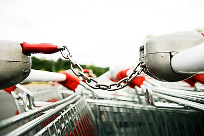 Shopping carts in a parking lot - p1084m1036784 by GUSK