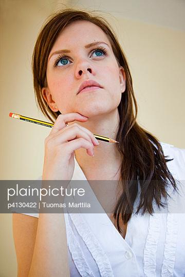 Woman with pencil - p4130422 by Tuomas Marttila