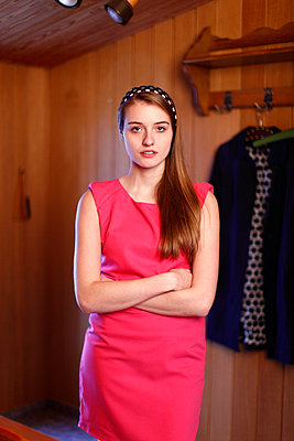 Young woman with pink dress - p249m1002930 by Ute Mans
