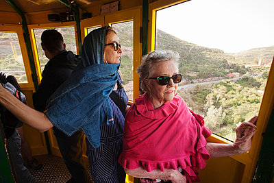 Women in cableway carriage - p312m765730f by Per Eriksson