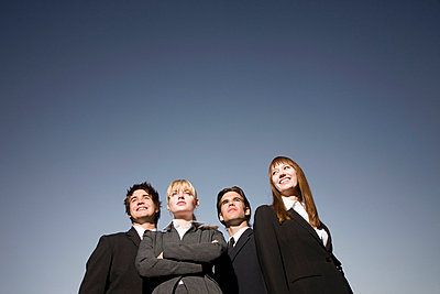 Group of businessmen and businesswomen - p4428208f by Design Pics