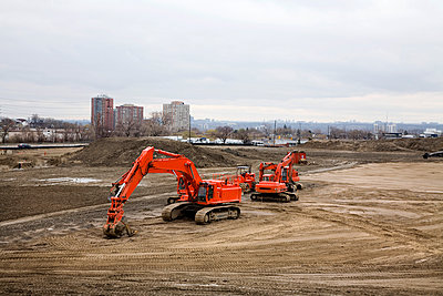 Backhoe Machines At A Construction Site - p442m935971 by Benjamin Rondel
