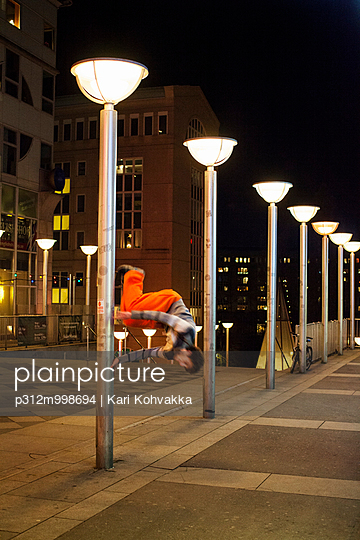 Man practicing parkour at night
