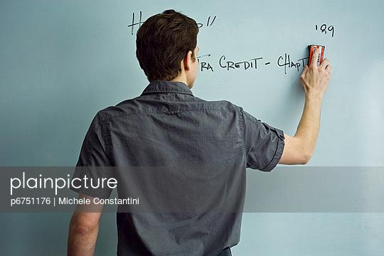 Teacher erasing whiteboard after class