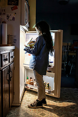 Kid raiding the fridge  - p1019m1122377 by Stephen Carroll