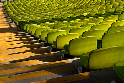 Germany, Bavaria, Munich, View of green seats in olympic stadium - p300m879127 by Paul Seheult
