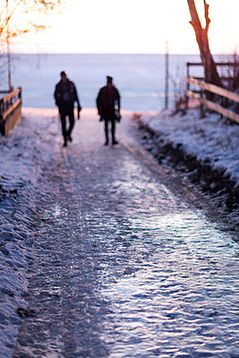 Silhouettes of people walking at winter - p312m1114109f by Henrik Trygg