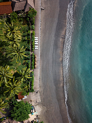 Indonesia, Bali, Aerial view of beach with empty sun loungers - p300m2042613 von Konstantin Trubavin