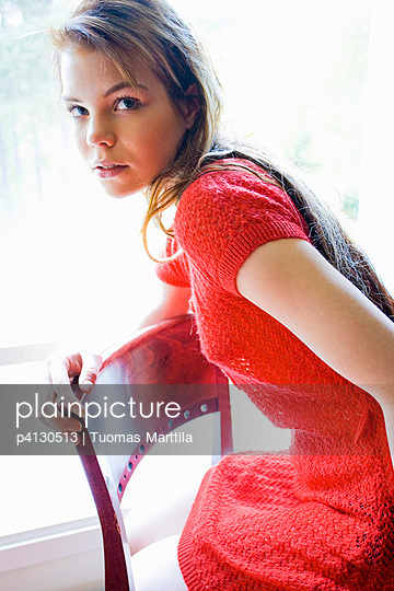 Woman wearing red dress - p4130513 by Tuomas Marttila