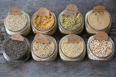 Still life variety of healthy seeds and grains with labels in jars - p1192m1213095 by Hero Images