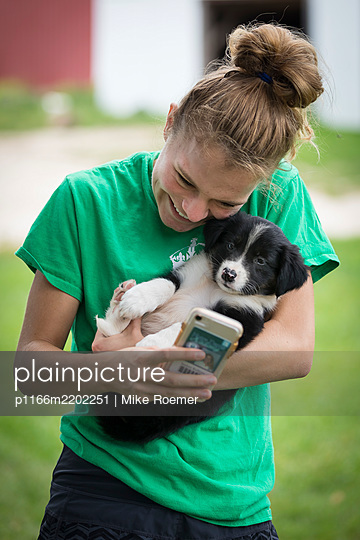 Teenage Girl With A Puppy - p1166m2202251 by Mike Roemer