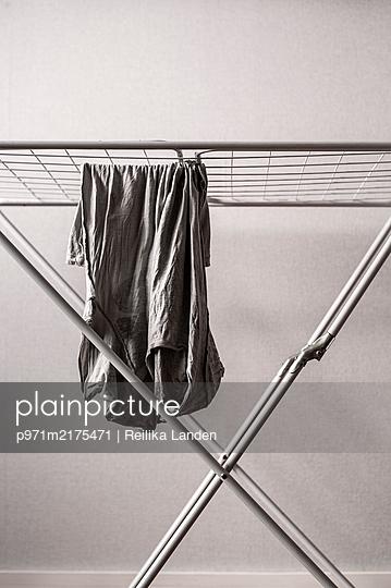 Shirt hanging on clothesline - p971m2175471 by Reilika Landen