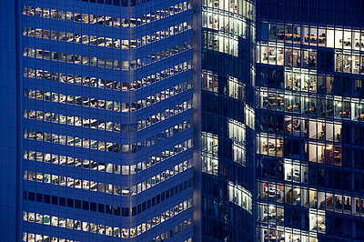 Office buildings by night - p1354m2292926 by Kaiser