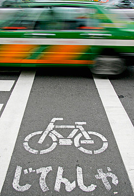 Taxi Driving Over Bicycle Path, Blurred Motion - p644m728136 by Mark Thomas