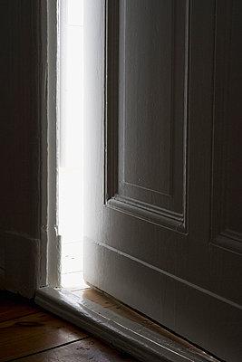 Light shining through a door left ajar - p30113480f by Halfdark