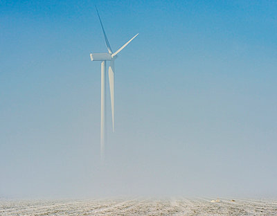 Wind turbine in snowy landscape - p429m817456 by Mischa Keijser