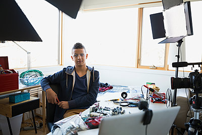 Portrait confident boy videotaping circuit board assembly - p1192m1129552f by Hero Images