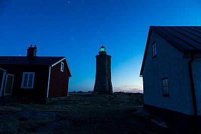Lighthouse at dusk - p312m1192814 by Henrik Trygg