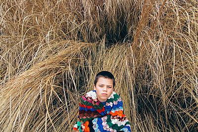 Child Wrapped in Colorful Blanket - p1262m1087730 by Maryanne Gobble