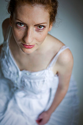 Woman with freckles - p4130666 by Tuomas Marttila