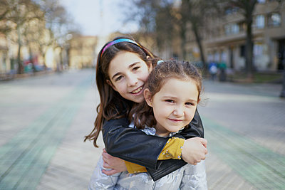 two happy girls look at the camera with a smile - p1166m2193869 by Cavan Images