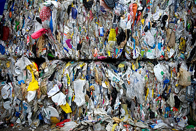 Plastic bags and bottles at a recycling plant - p343m1033220 by Peter Dennen