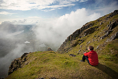 Hiker overlooking view from mountaintop - p42915888f by Philip Lee Harvey