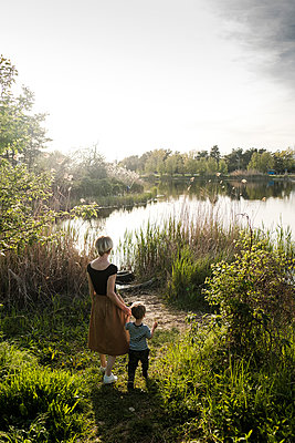 Woman and son near river - p1363m2134660 by Valery Skurydin
