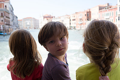 Kids on a boat in Venice - p1308m2126706 by felice douglas