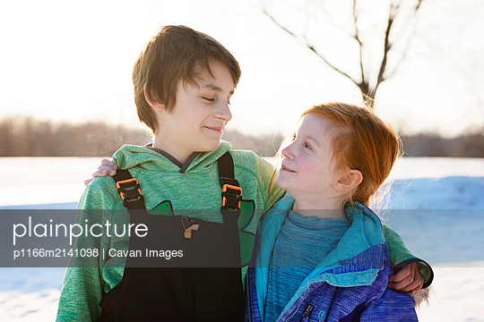 Boy and Girl Friends Outdoors in Winter - p1166m2141098 by Cavan Images