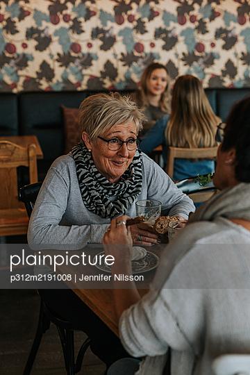 Women having coffee in cafe - p312m2191008 by Jennifer Nilsson